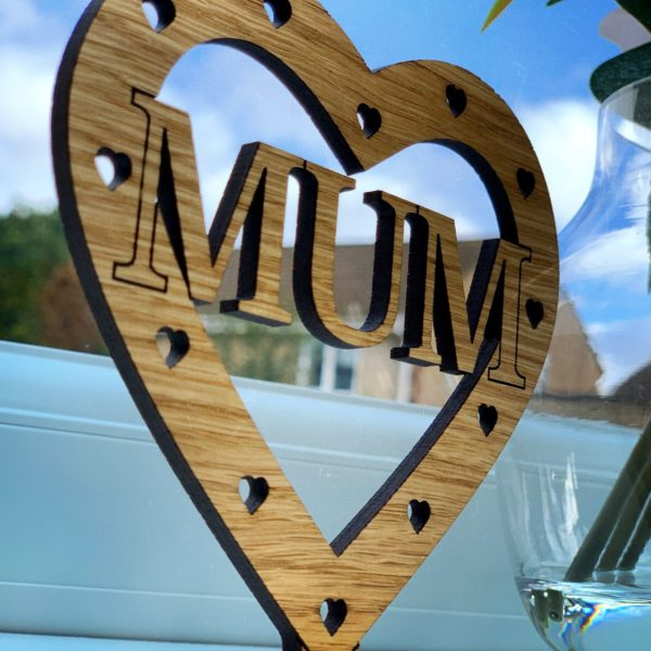 a unique mother's day gift - personalised 'cut mum' freestanding oak heart gift