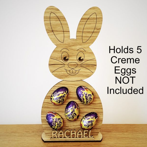 a fun easter gift - personalised 'easter bunny' holds 5 cadbury's creme eggs freestanding oak rabbit gift