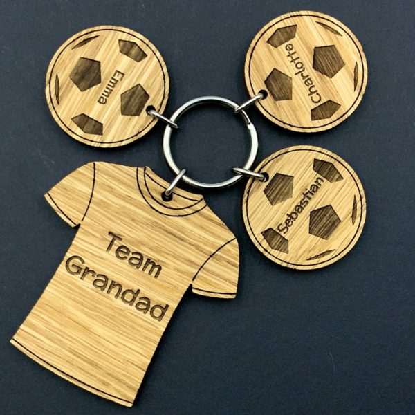 """a great father's day gift for your football & family loving dad - oak """"team dad"""" shirt with family team members names on balls"""
